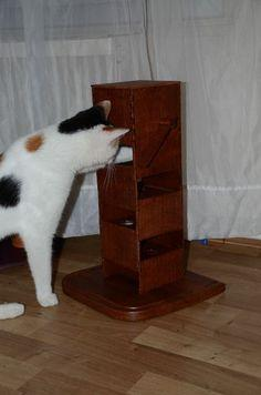 Wooden cat puzzle feeder tower